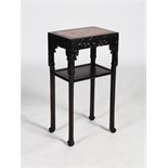 A Chinese dark wood jardiniere stand, Qing Dynasty, the rectangular top with mottled red and white