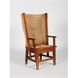 A late 19th/early 20th century pine Orkney chair, with woven drop in upholstered seat, 106cm high.