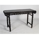 A Chinese dark wood altar table, late 19th/early 20th century, the rectangular panelled top above