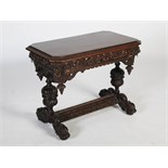 A late 19th century oak centre table, the rectangular top with canted angles above a long frieze