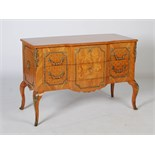 A French Louis XVI style marquetry and gilt metal mounted commode, the altered hinged top opening to