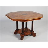 A 19th century pollard oak and ebony lined octagonal shaped centre table, the shaped top centred