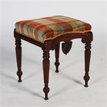 A William IV mahogany stool, the upholstered seat above a frieze carved with inverted anthemion