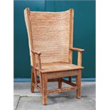 A late 19th/early 20th century stained pine Orkney chair, the woven back and solid planked seat