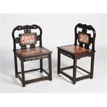 A pair of Chinese dark wood and mother of pearl inlaid side chairs, late Qing Dynasty, the shaped