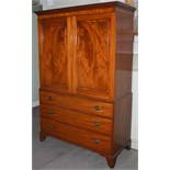 A 19th century mahogany linen press, the moulded cornice and dentil frieze above a pair of