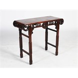 A small Chinese dark wood altar table, the rectangular panelled top above a pierced frieze centred