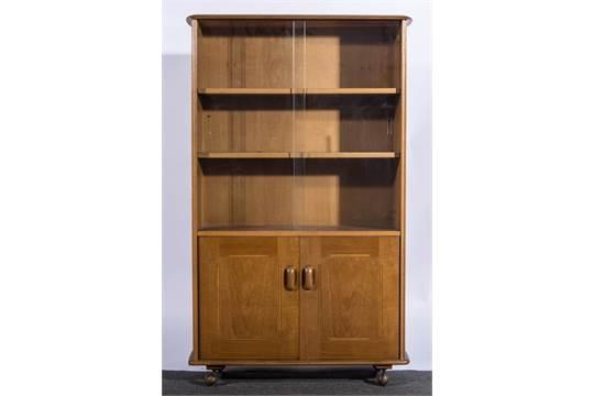 An Ercol Blonde Beech Bookcase Cabinet Sliding Gl Doors