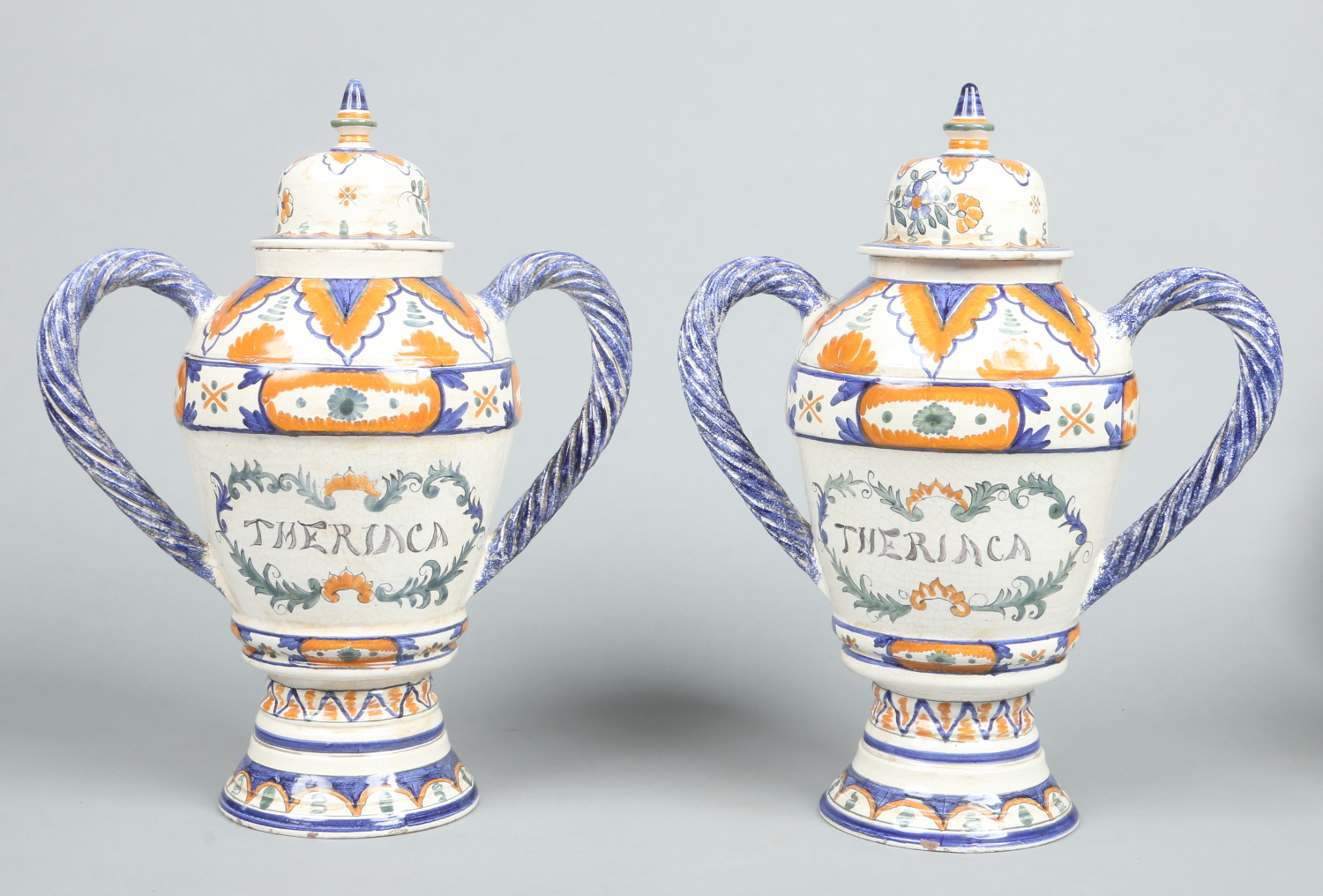 Lot 144 - A pair of Continental faience Theriac drug jars.