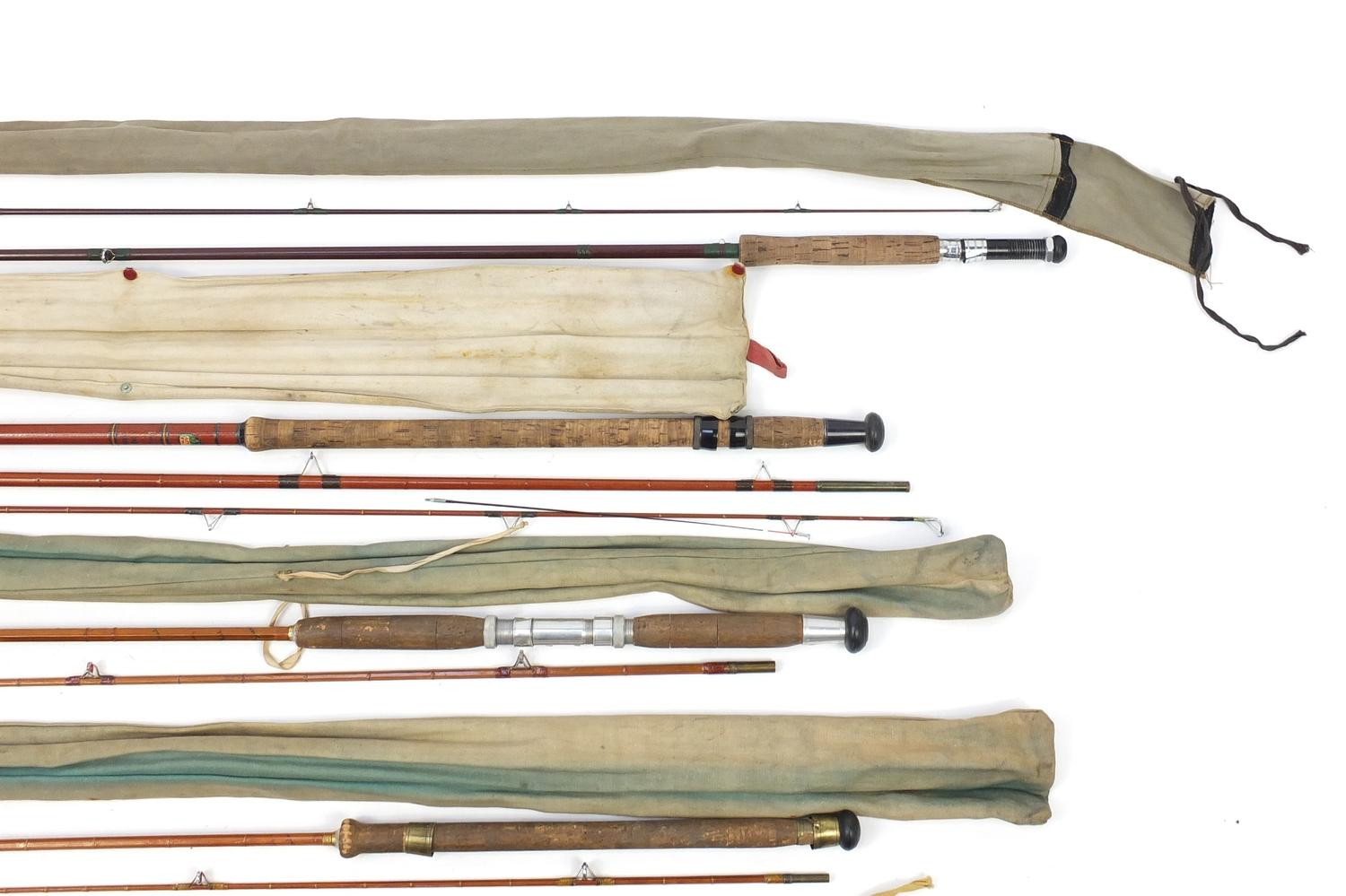 Lot 116 - Five vintage fishing rods including two Hardy split cane spinning rods, Allcocks Little Gem split