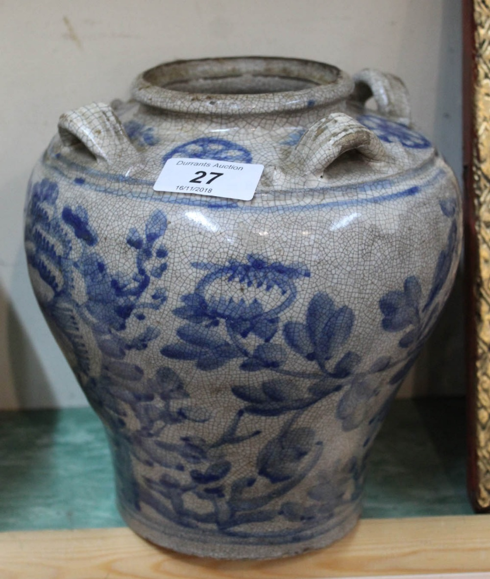 Lot 27 - A bulbous 19th Century Chinese porcelain blue and white decorated crackle ware vase with four
