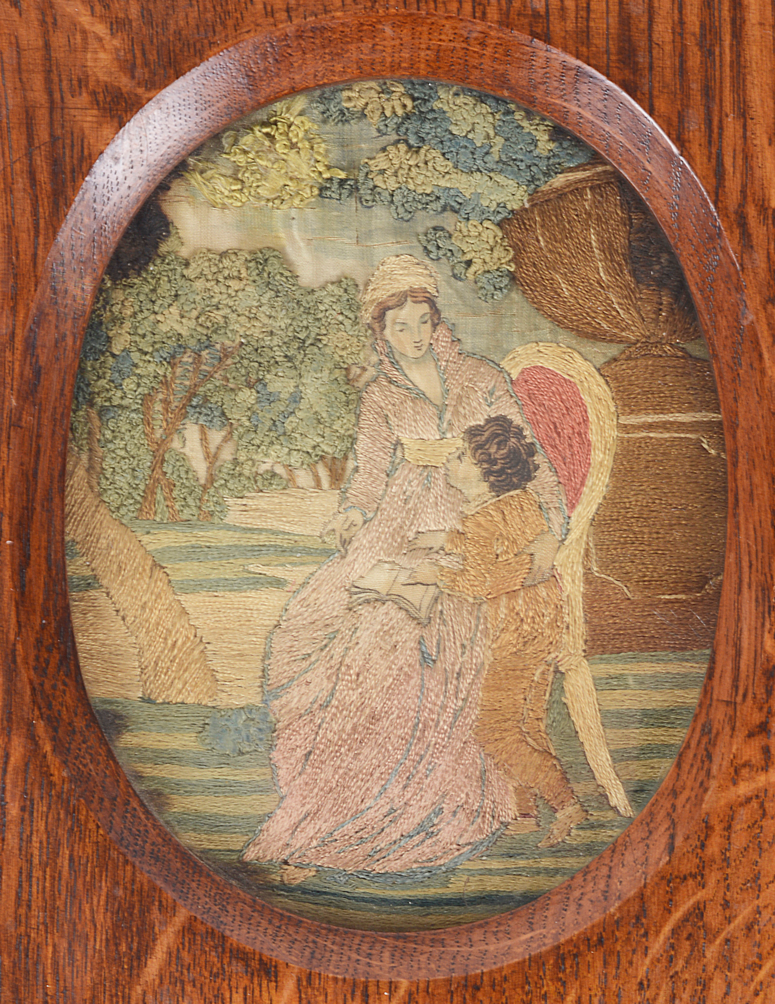 Lot 14 - A small early 19th century silk needlework picture of a mother and child