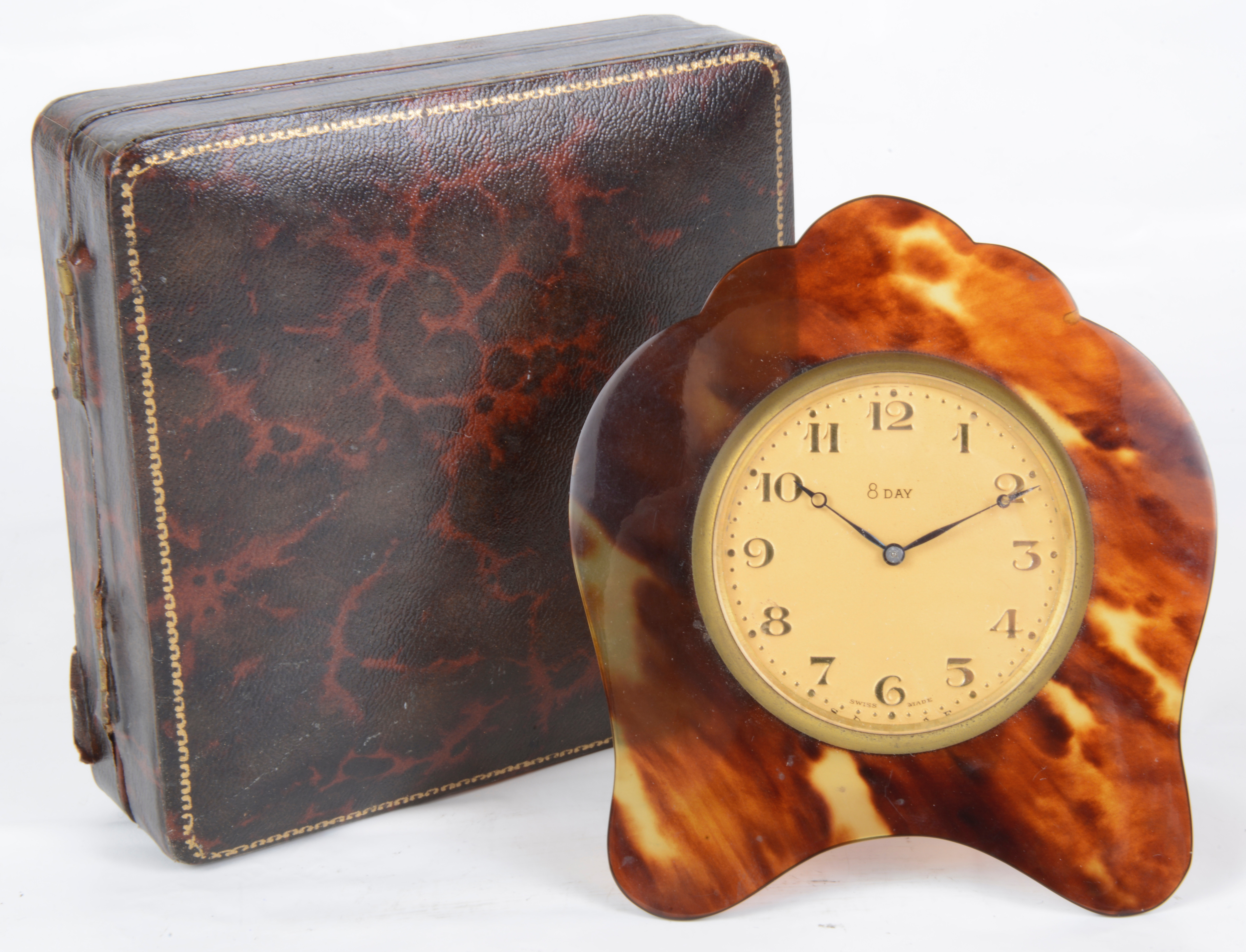 Lot 37 - A faux tortoiseshell travelling clock
