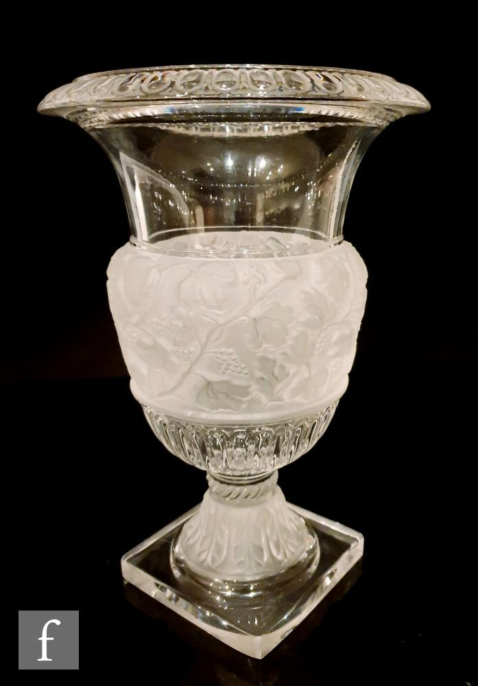 A large 20th Century clear crystal glass vase in the manner of Baccarat of pedestal urn form on a