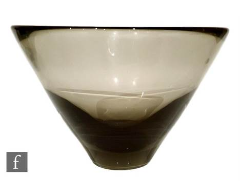 A post war Holmegaard glass bowl designed by Per Lutken, of asymmetrical flared form in a deep cinnamon tint, engraved signat