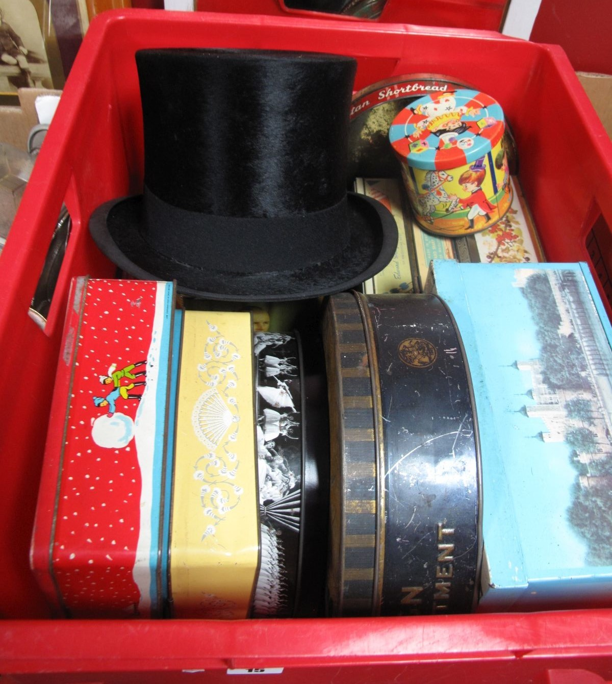 Lot 15 - An Austin Reed Black Top Hat, a quantity of tins:- One Box