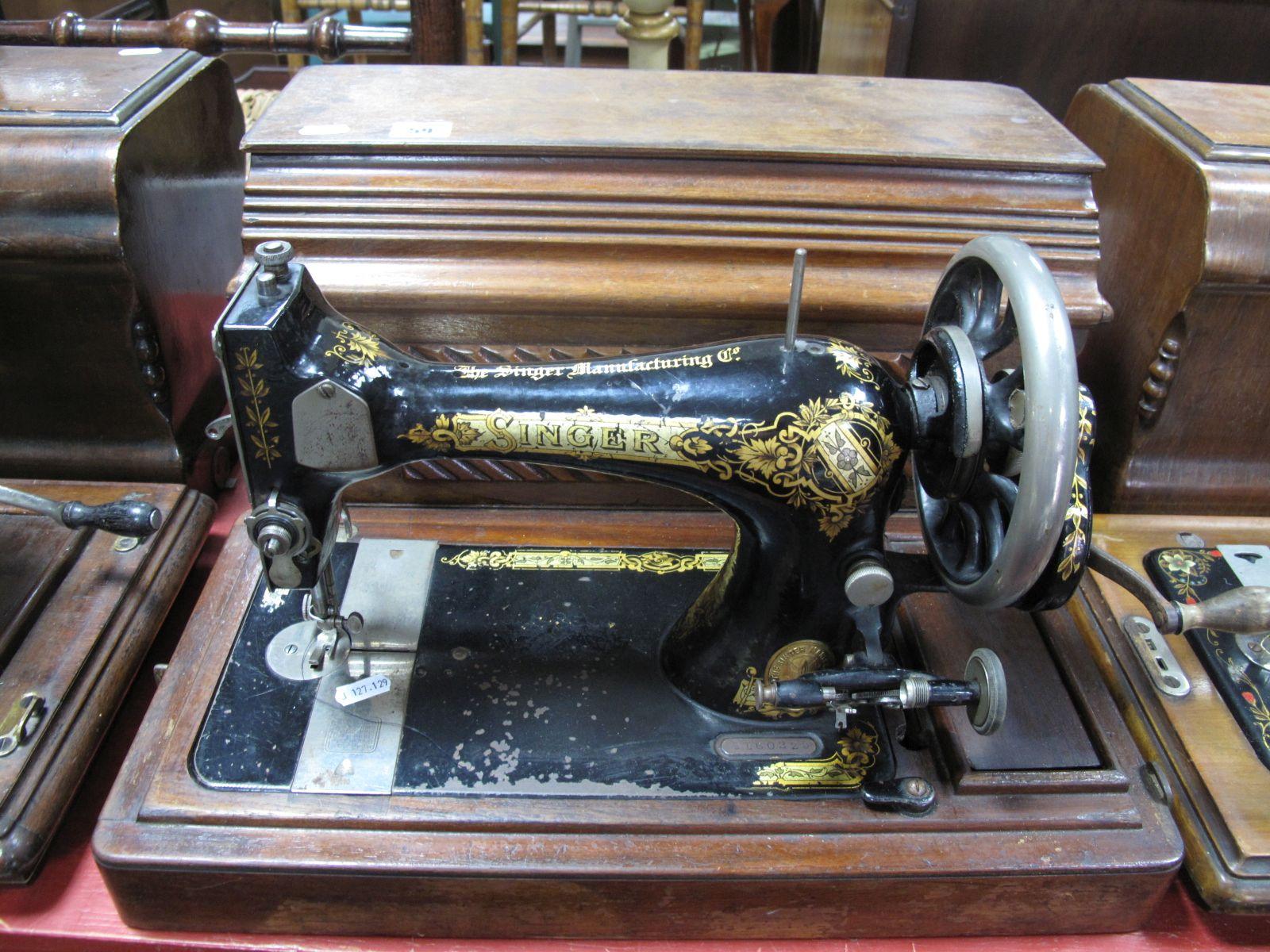 Lot 59 - An Early XX Century Singer Sewing Machine, in walnut case.