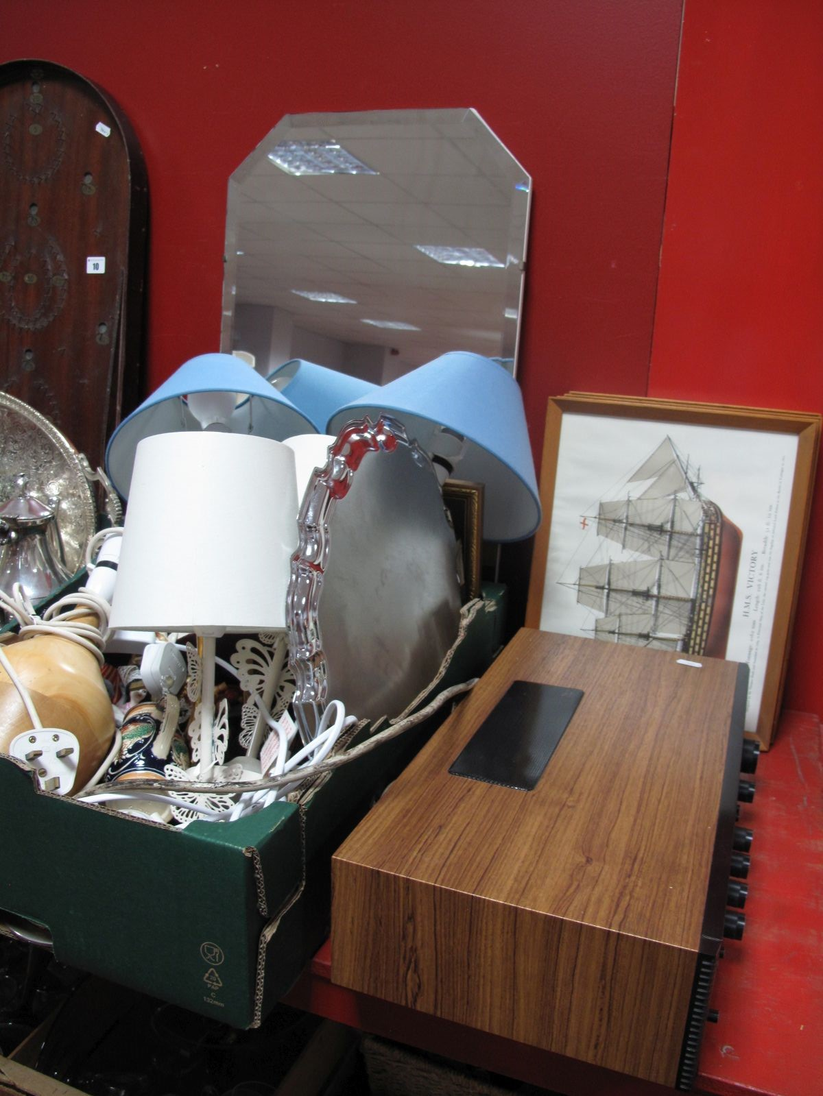 Lot 11 - A Bevelled Wall Mirror, ship themed prints, National costume dolls, table lamps, Cunningham print,