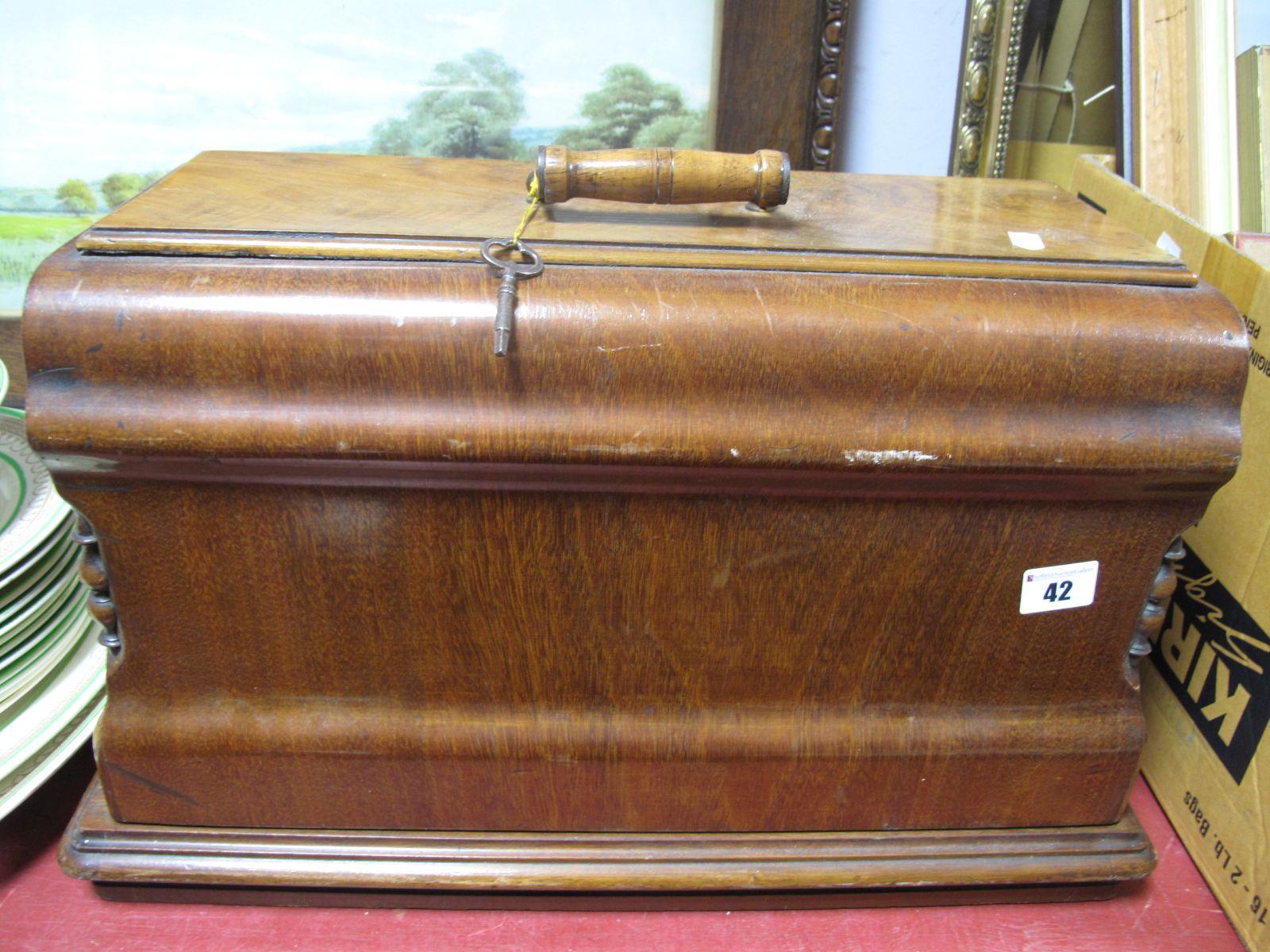 Lot 42 - A Jones Sewing Machine and Accessories, in walnut case.