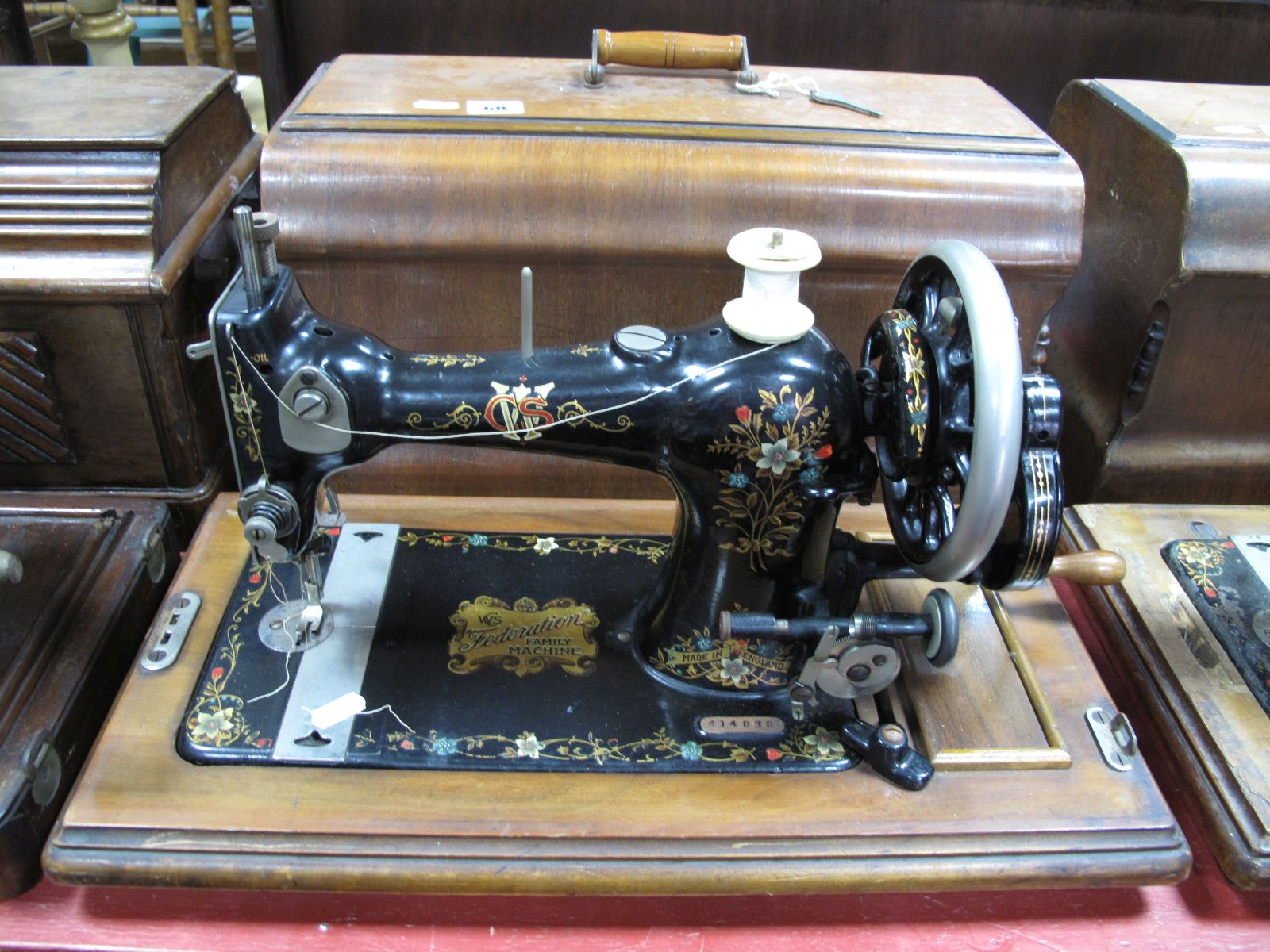 """Lot 60 - An Early XX Century CWS """"Federation Family Machine"""" Sewing Machine, numbered 414838, in walnut case."""