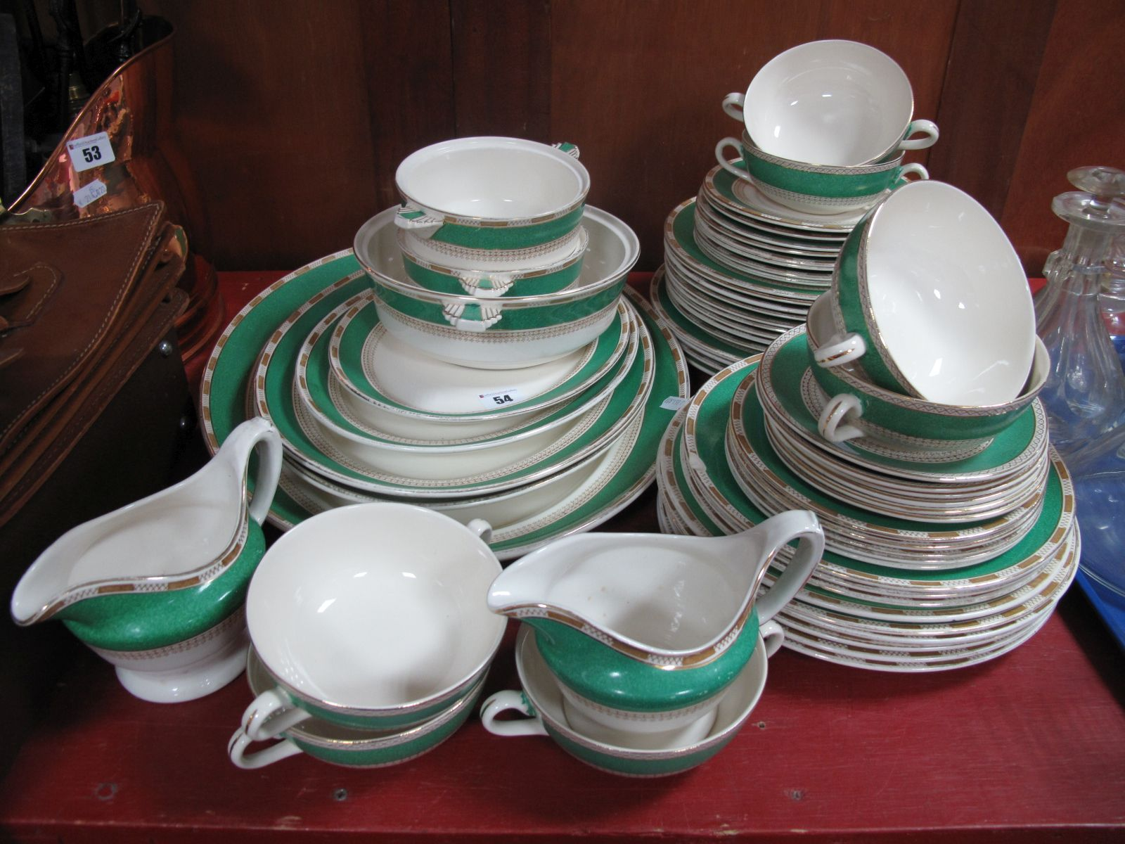 Lot 54 - Losol Green and Gilt Banded Dinner Ware, of approximately fifty-eight pieces.