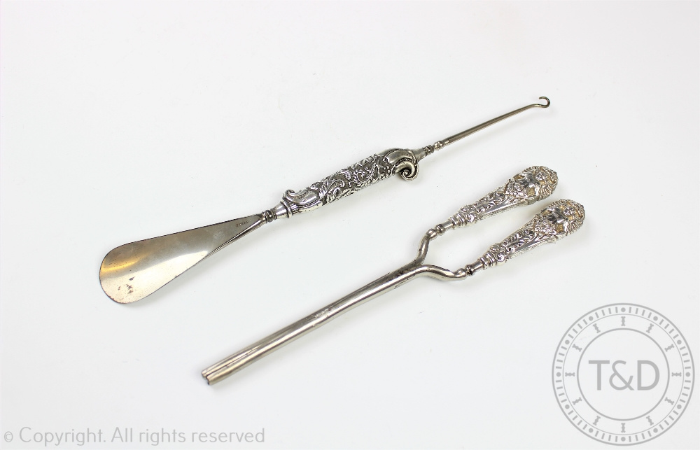 Lot 56 - A pair of Victorian silver handled glove stretchers, Crisford & Norris Ltd, Birmingham 1900,
