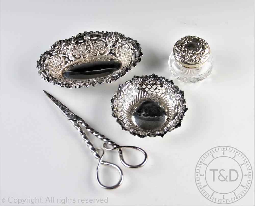 Lot 30 - A selection of silver comprising; a pair of silver grape scissors, L & S, Sheffield 1991,