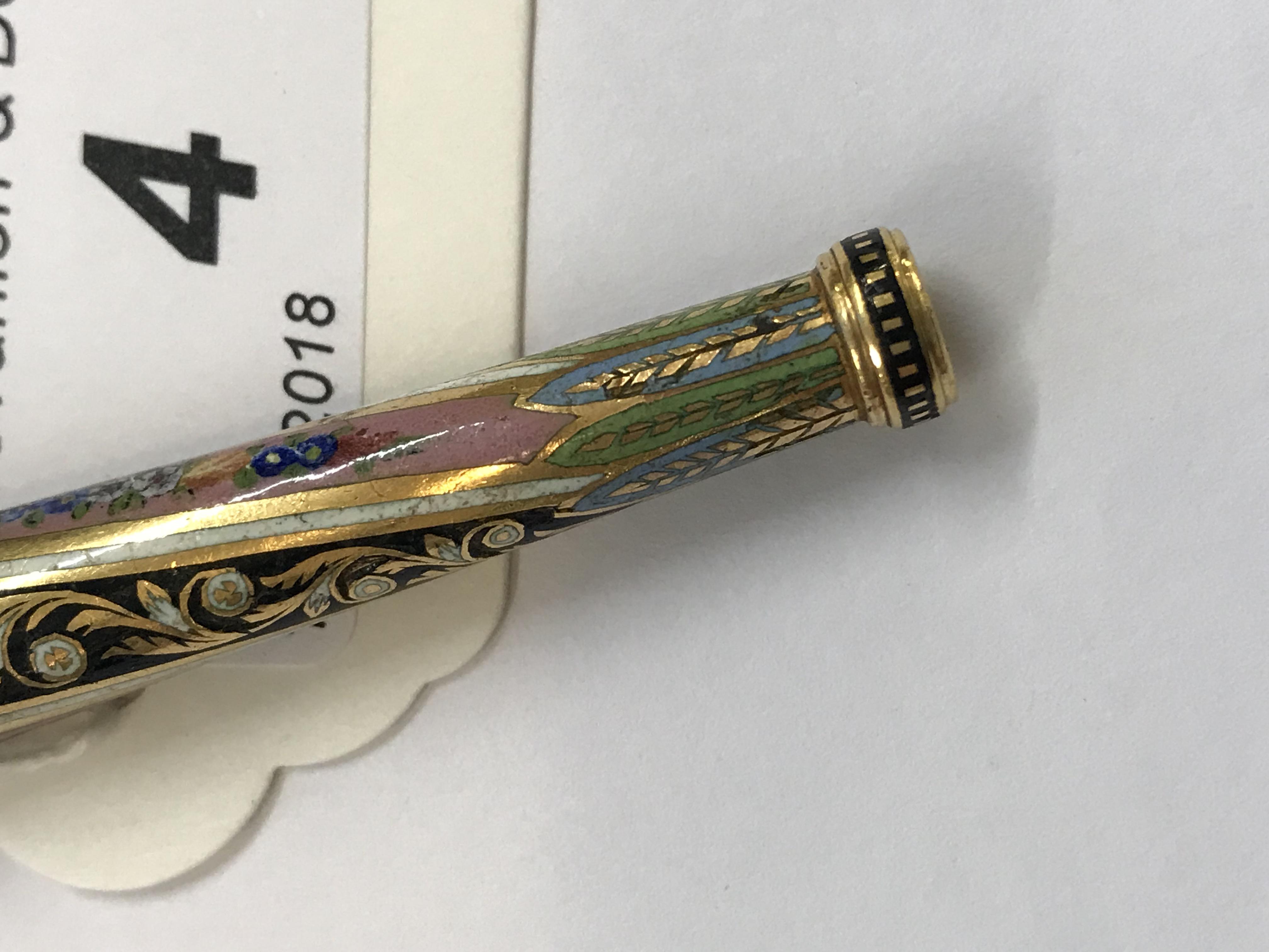 Lot 4 - A 19th century European enamelled and gilt metal cigarette holder,