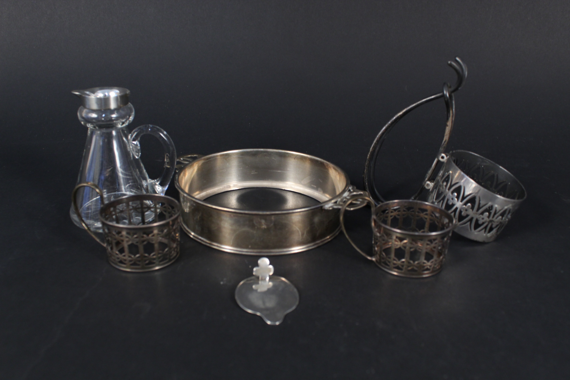 Mixed silver items including cup holders with pierced design,