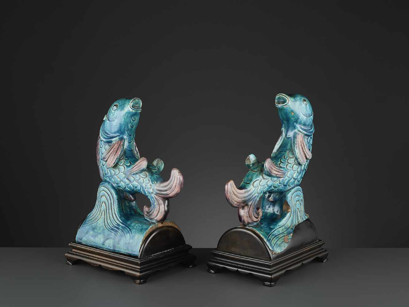 Los 404 - TWO AUBERGINE AND TURQUOISE GLAZED 'FISH' ROOF TILES, MING <br