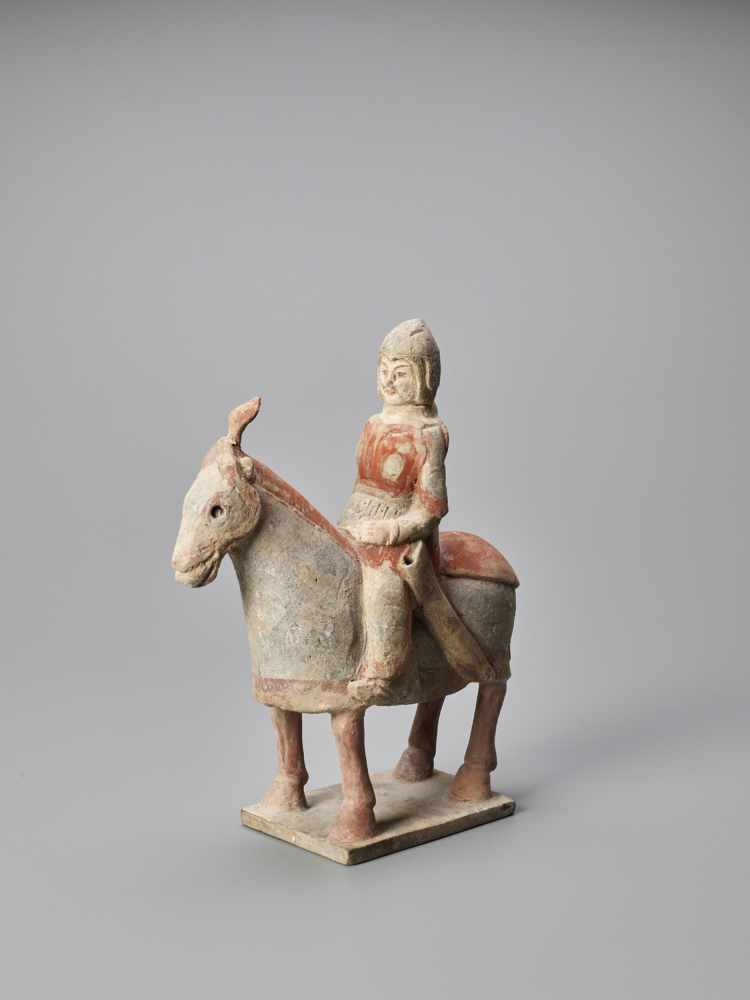 A TERRACOTTA FIGURE OF A HORSE AND RIDER, NORTHERN WEI