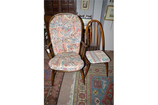 A set of four Ercol spindle back chairs together with an Ercol