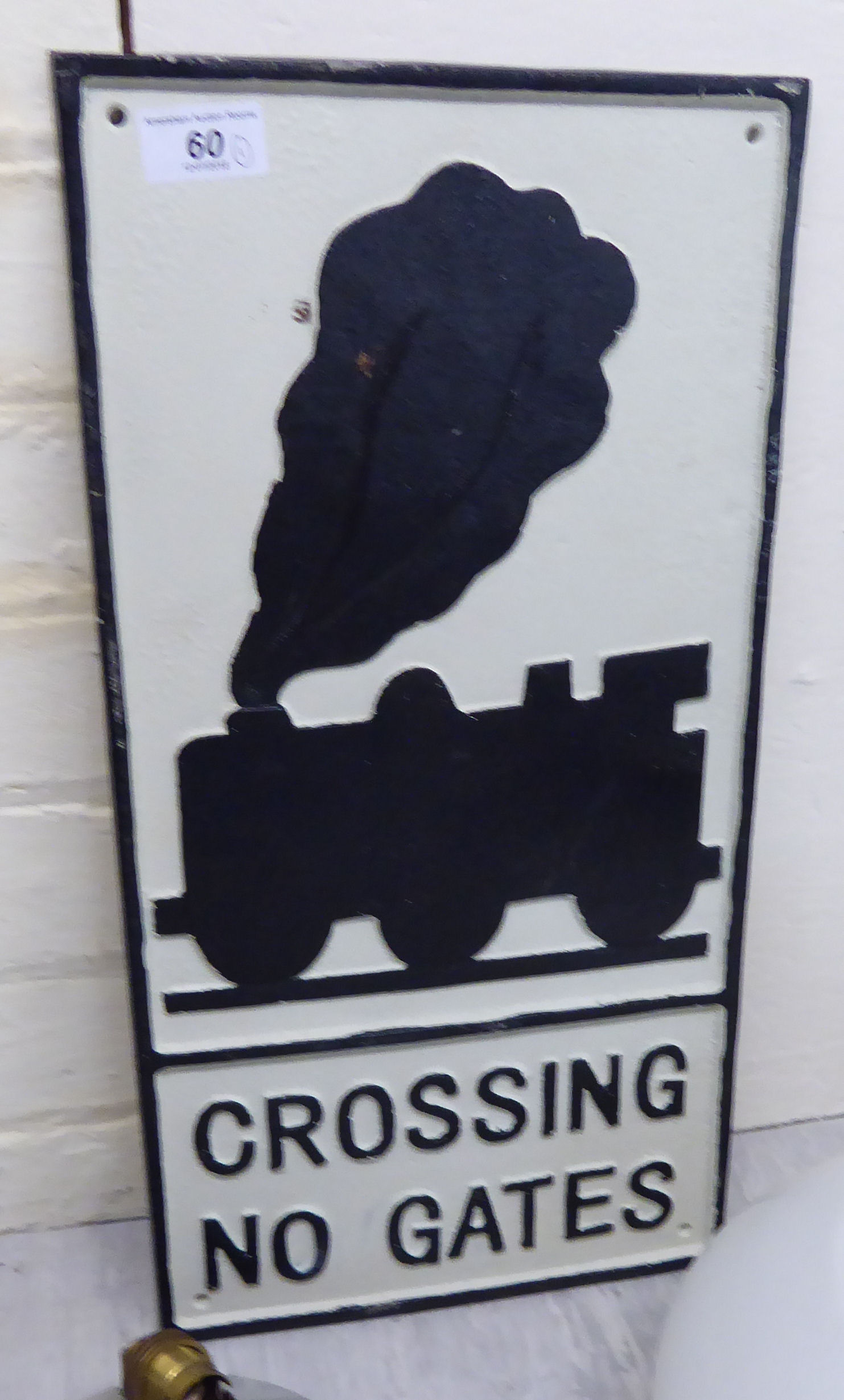 Lot 60 - A cast iron sign 'Crossing,