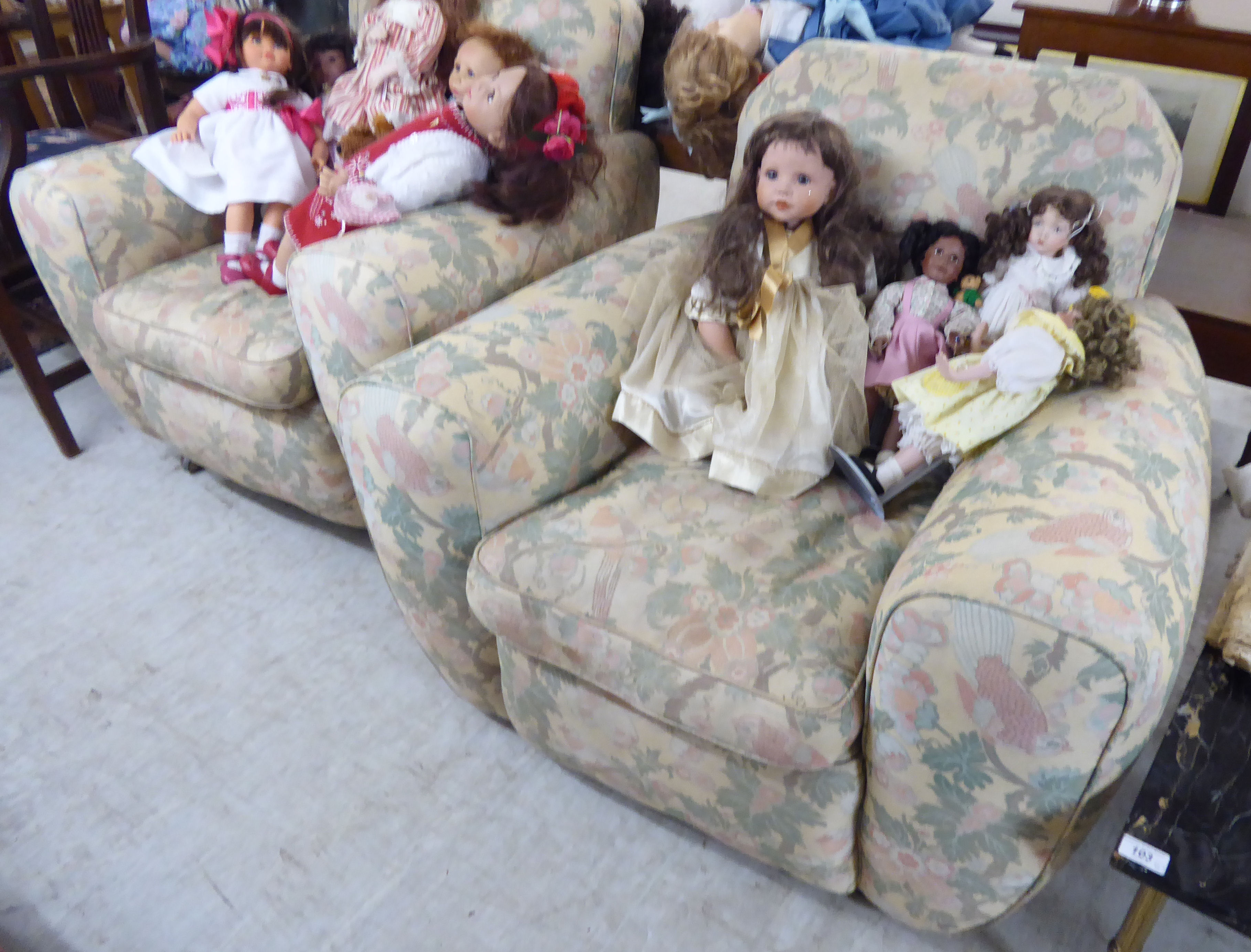 Lot 7 - A pair of late Victorian armchairs, the birds and floral fabric upholstered backs,