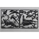 A pair of Lauchhammer Art Deco cast & pierced iron square panels depicting running hares, a fox, &