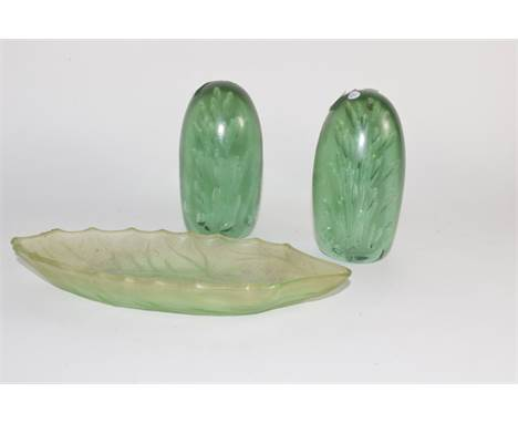 Pair of Nailsea type green paperweights together with a further green glass dish (3)