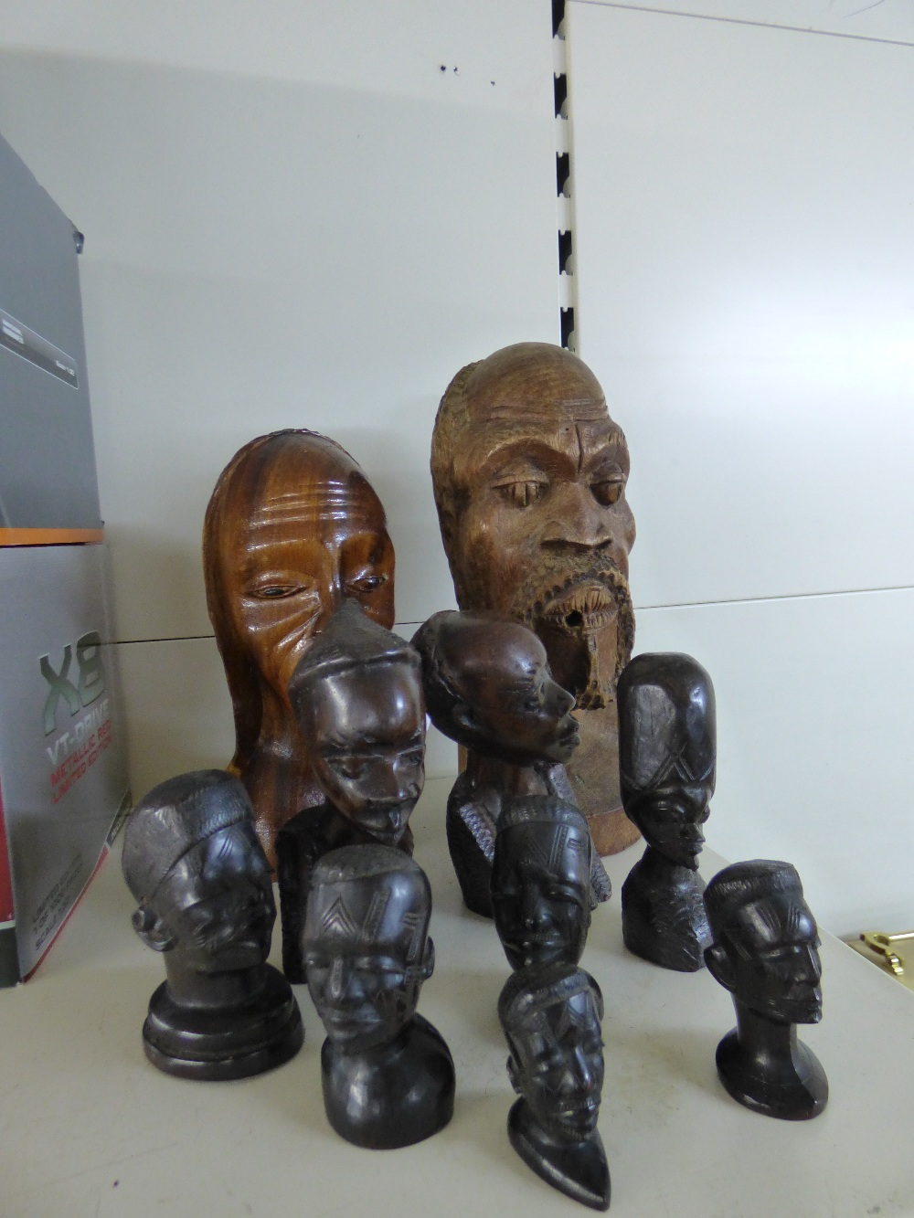 Lot 3 - COLLECTION OF AFRICAN STYLE CARVED WOOD BUSTS