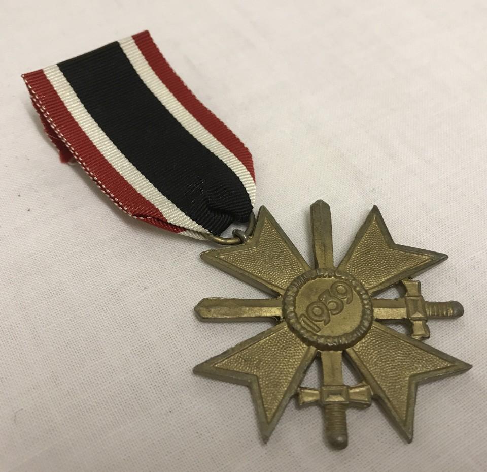 Lot 252 - German WWII pattern War Merit cross with swords medal.