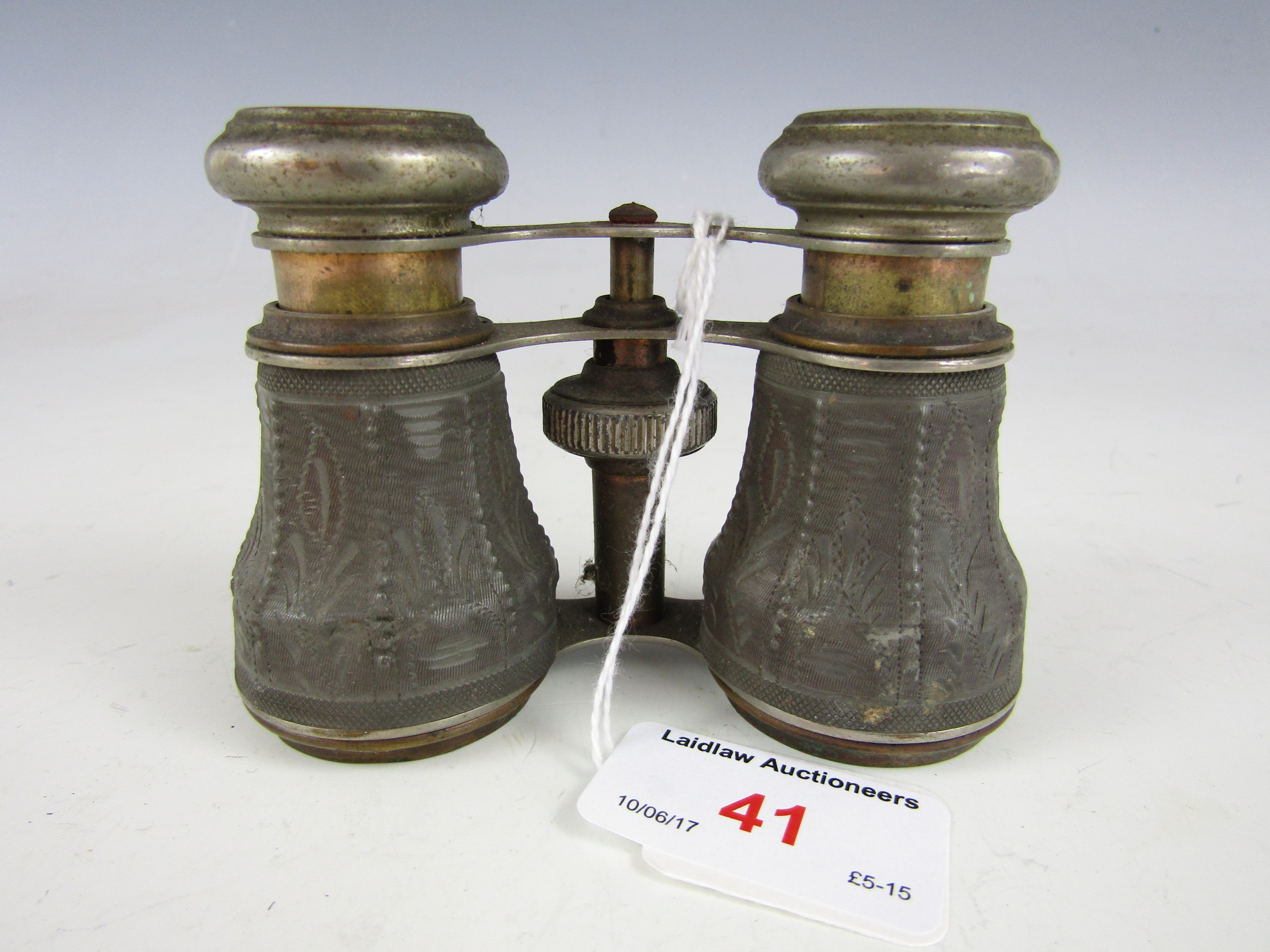 Lot 41 - A pair of 19th Century opera glasses with carved decoration to the body