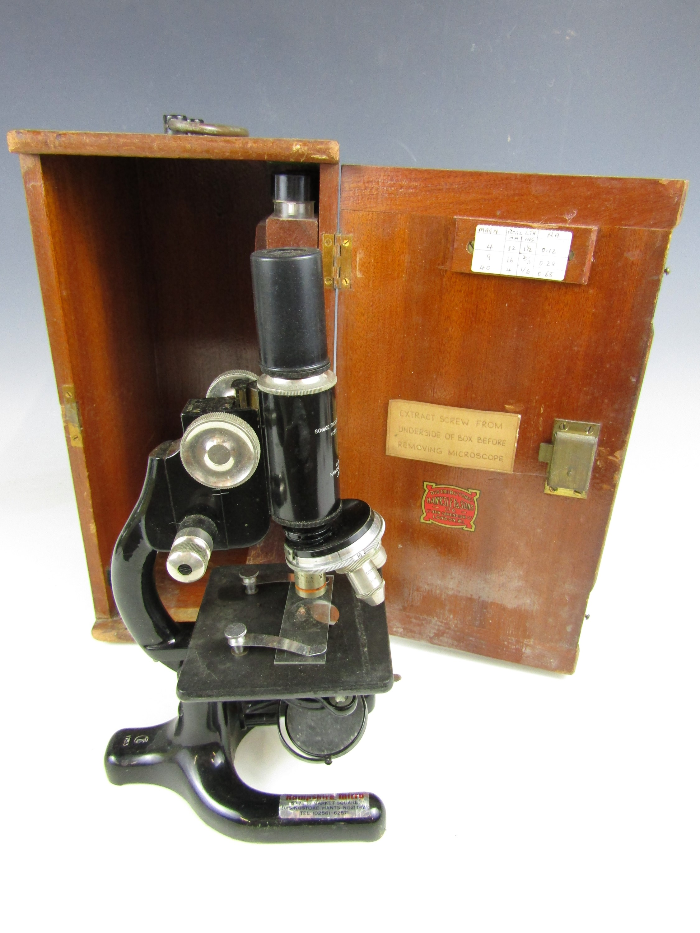 Lot 11 - A vintage Hawkesley and Sons of London microscope in a fitted wooden case
