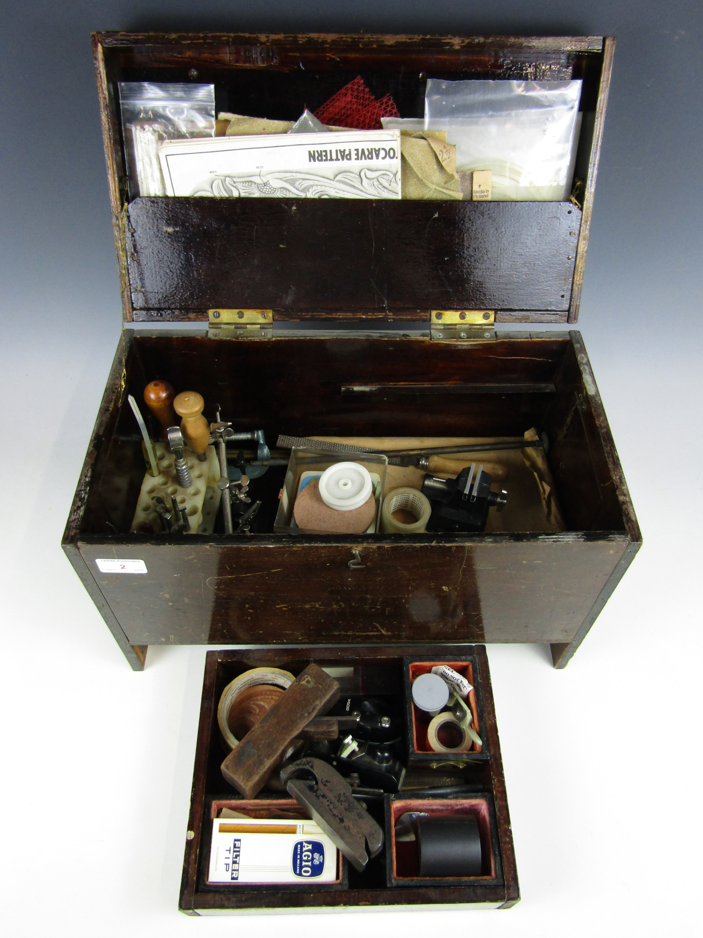 Lot 2 - A vintage wooden case containing a large quantity of leather working and other tools etc.