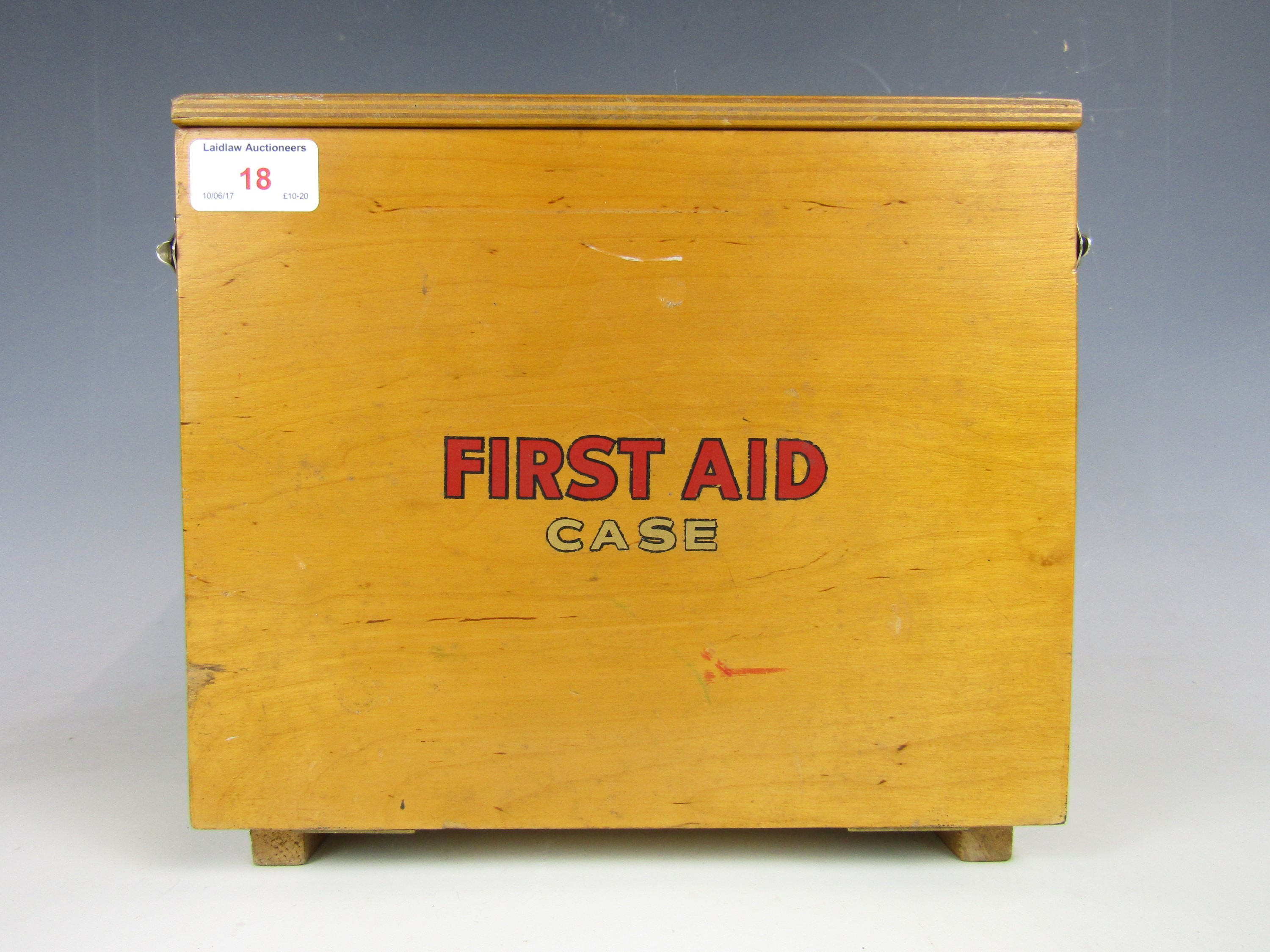 Lot 18 - A 1950's First Aid box with contents including printed triangular bandages