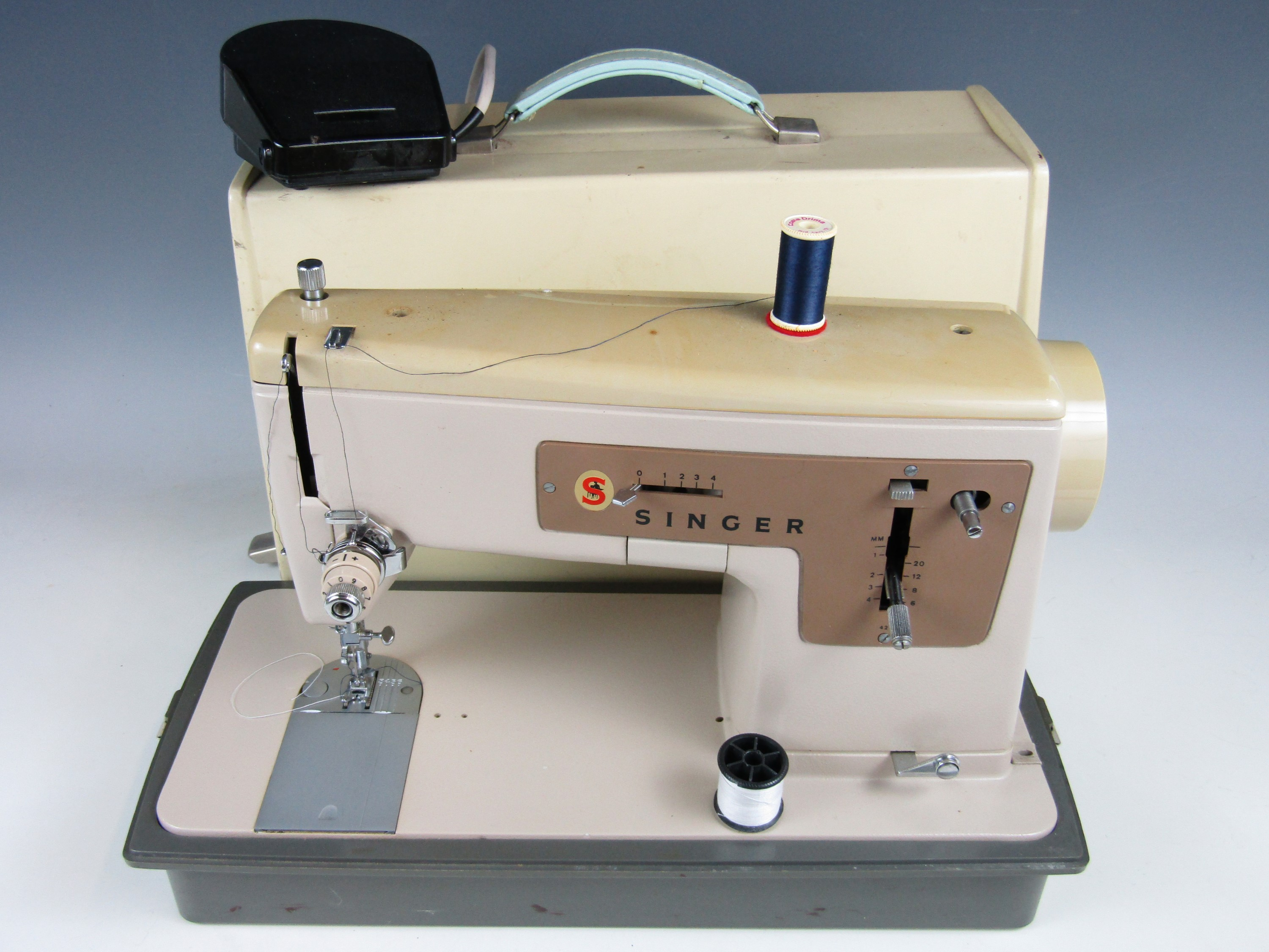 Lot 22 - A vintage Singer electric sewing machine
