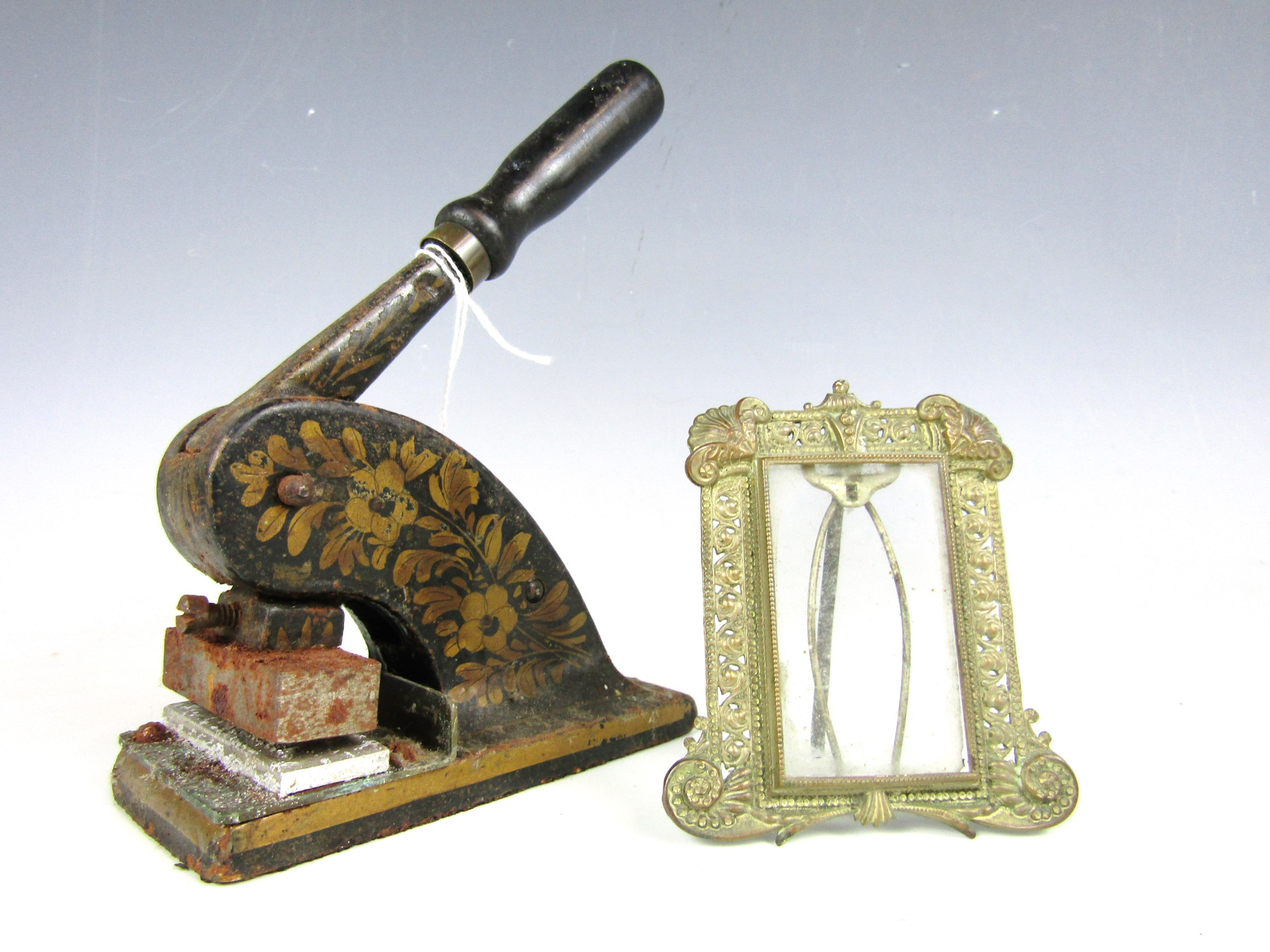 Lot 13 - A Victorian letterhead blind embossing press together with a small metal photograph frame