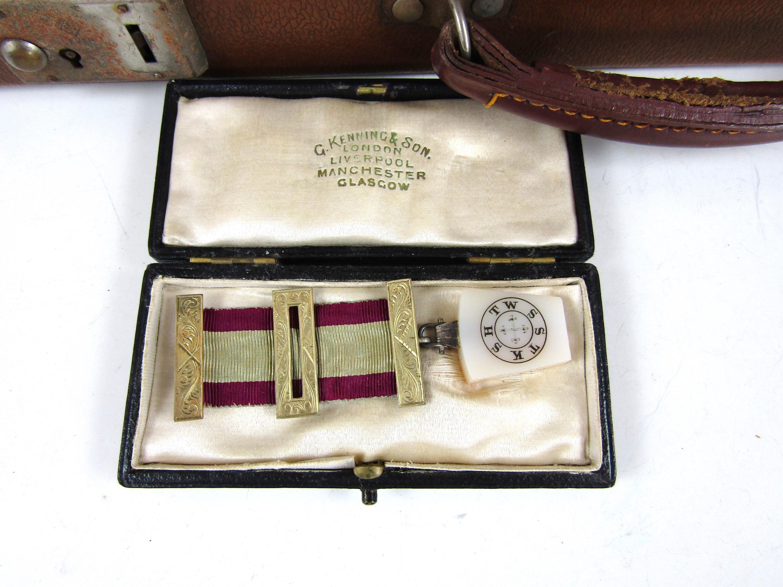 Lot 7 - A vintage Masonic case containing a medallion and regalia