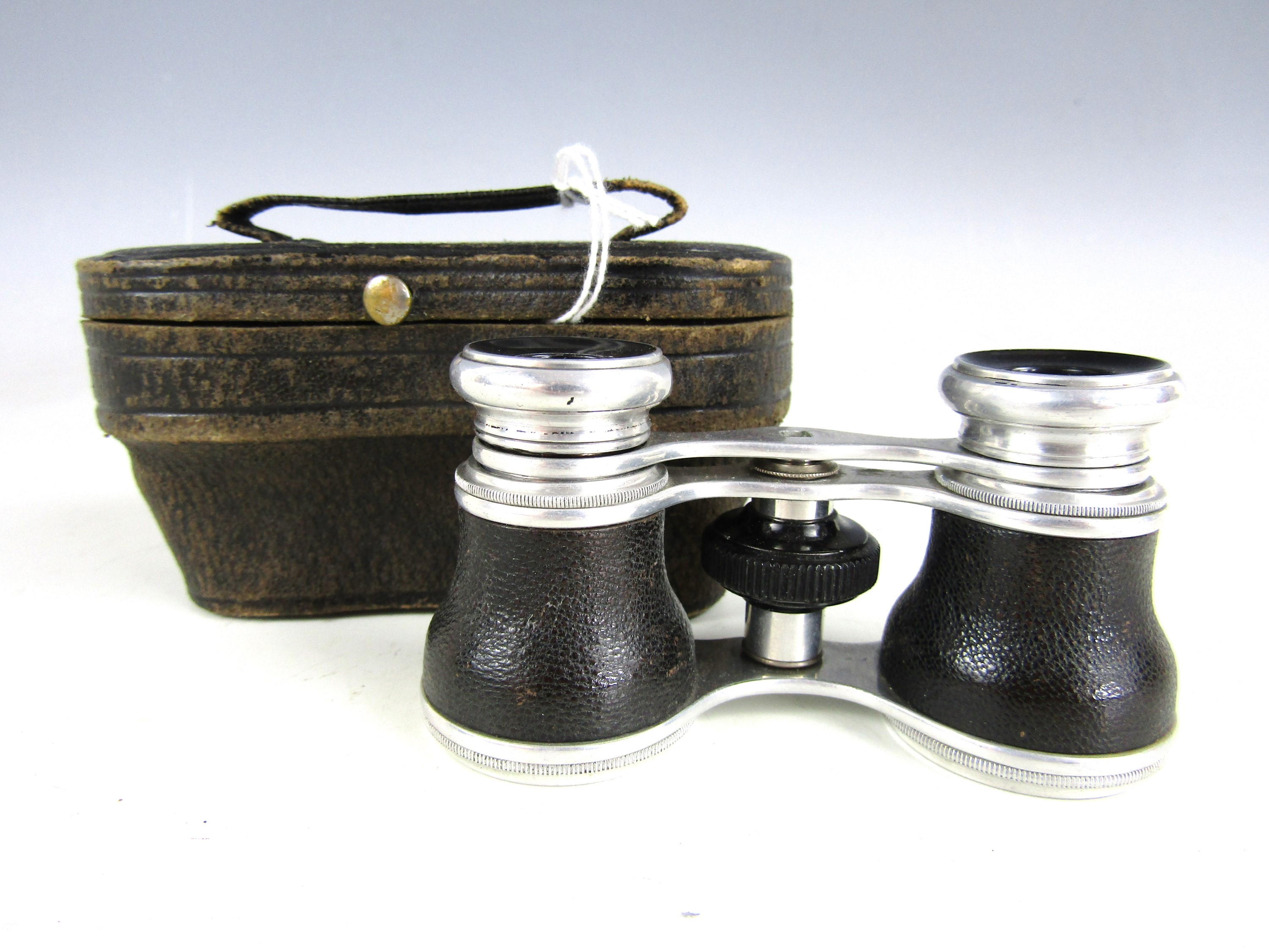 Lot 8 - A vintage pair of cased opera glasses