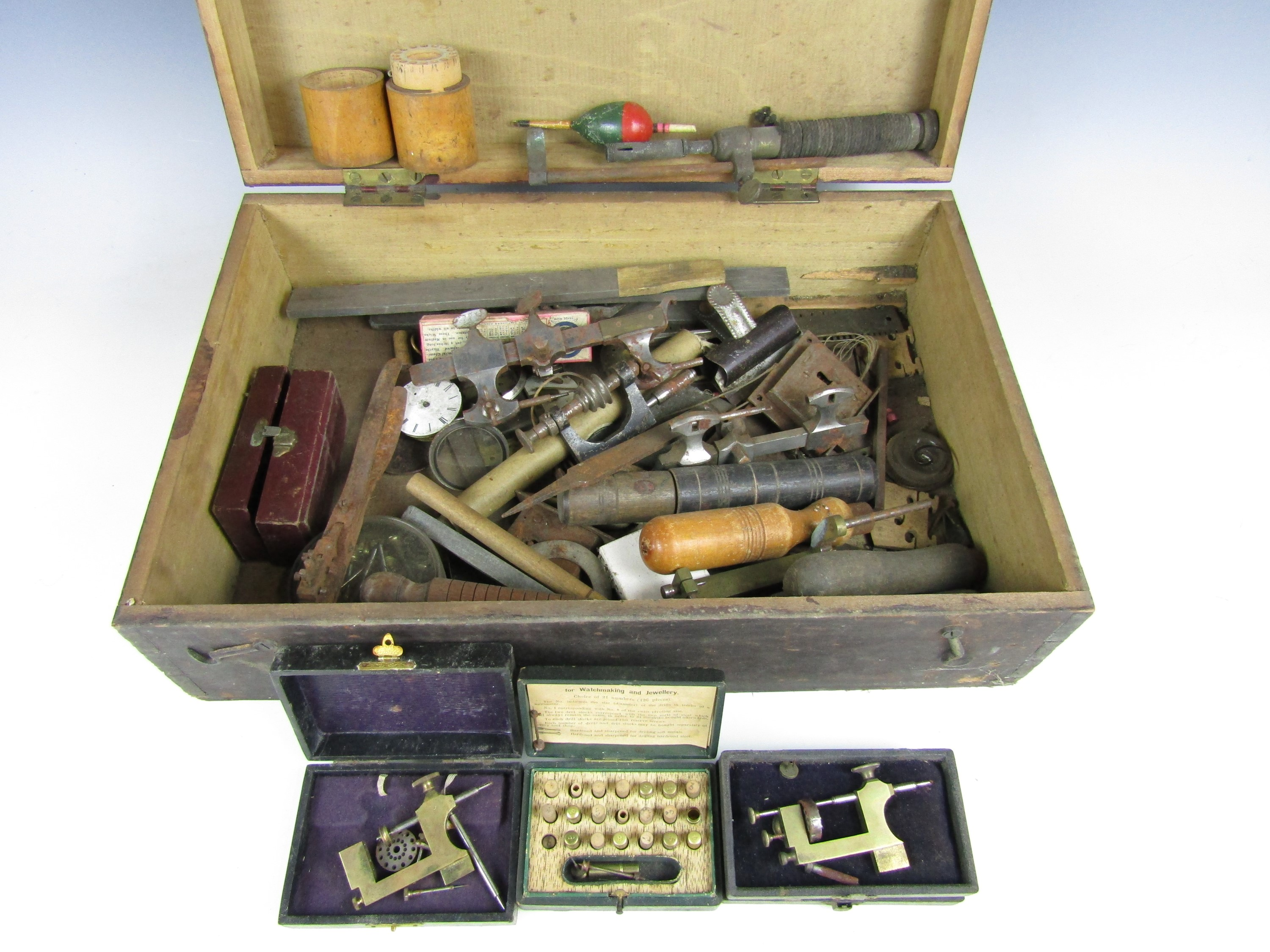 Lot 23 - A wooden box containing vintage watchmakers' tools etc.