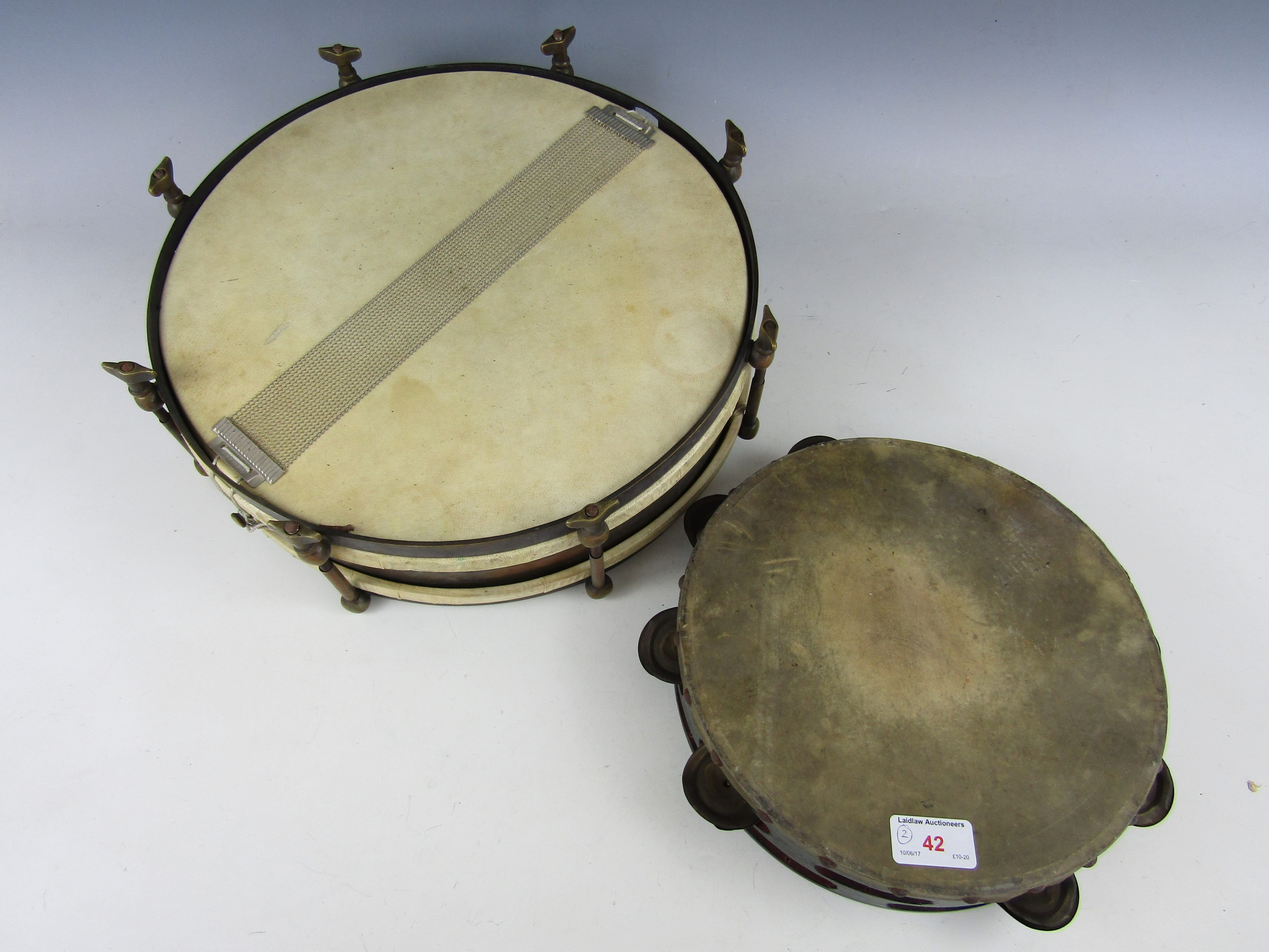 Lot 42 - A vintage tambourine and drum