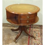 A 20th century mahogany drum table in the Regency style, the circular top inset with leather above