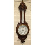 W H May, Nottingham, a carved stained mahogany banjo aneroid barometer/thermometer, 90cm high.